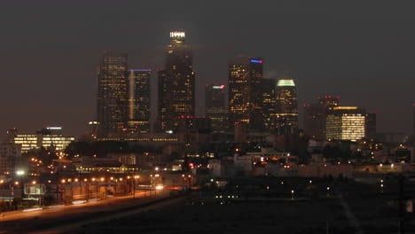 Time-lapse-motion-of-cars-and-train-commuting-into-Los-Angeles-at-dawn-California