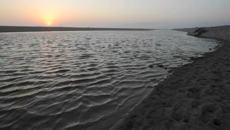 Time-lapse-of-sun-setting-over-a-coastal-estuary-at-McGrath-Beach-State-Park-in-Ventura-California