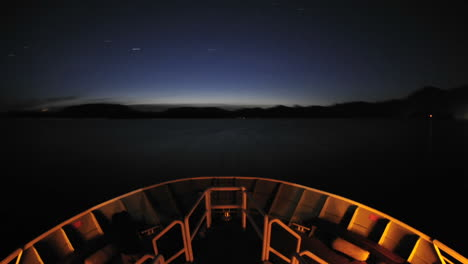 Point-of-view-time-lapse-of-a-ship-leaving-Sitka-at-night-and-cruising-up-Olga-Strait-in-Southeast-Alaska