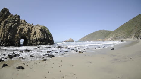 Time-lapse-of-waves-breaking-on-a-beach-and-through-a-rock-at-Pfeiffer-Beach-in-Big-Sur-California