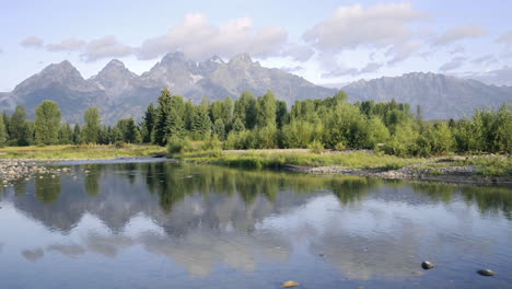 Time-lapse-of-clouds-mountains-and-forest-reflecting-at-Schwabacher-Landing-in-Grand-Teton-National-Park-Wyoming
