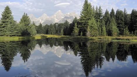 Time-lapse-motion-of-clouds-mountains-and-forest-reflecting-at-Schwabacher-Landing-in-Grand-Teton-National-Park-Wyoming