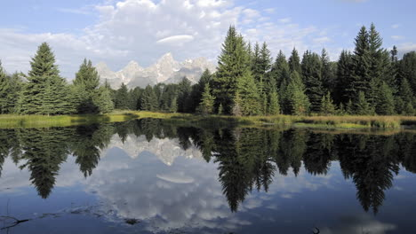 Time-lapse-of-clouds-mountains-and-forest-reflecting-at-Schwabacher-Landing-in-Grand-Teton-National-Park-Wyoming-1