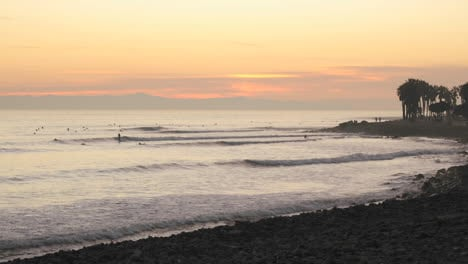 Time-lapse-of-waves-and-surfers-at-Ventura-Point-at-sunset-in-Ventura-California