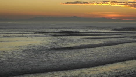 Time-lapse-close-up-of-surfers-and-waves-at-Ventura-Point-at-sunset-in-Ventura-California