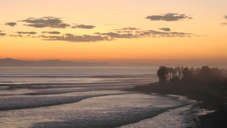 Close-up-time-lapse-of-clouds-and-waves-at-Ventura-Point-at-dusk-in-Ventura-California