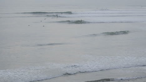 Close-up-time-lapse-of-surfers-catching-set-waves-to-the-beach-at-Ventura-Point-in-Ventura-California