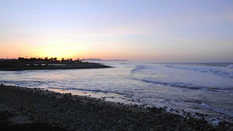 Waves-breaking-at-sunrise-at-Surfers-Point-from-Emma-Woods-State-Beach-in-Ventura-California