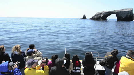 Sightseers-on-the-bow-of-a-boat-approaching-Anacapa-Island-in-Channel-Islands-National-Park-California