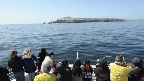 Sightseers-on-the-bow-of-a-boat-approaching-Anacapa-Island-in-Channel-Islands-National-Park-California-1