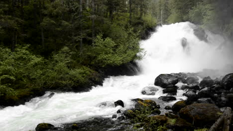 Pan-of-spring-melt-water-flowing-over-Cascade-Creek-waterfall-in-Thomas-Bay-Southeast-Alaska