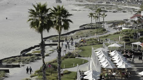 People-enjoying-the-bike-path-on-the-beach-in-front-of-the-Hotel-Del-Coronado-in-San-Diego-California