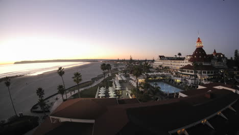 Day-to-night-time-lapse-of-the-sun-setting-and-lights-on-the-historic-Hotel-Del-Coronado-in-San-Diego-California