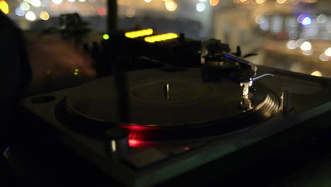 Closeup-of-a-disc-Jockey-spinning-records-and-playing-music-at-a-nightclub-in-San-Diego-California