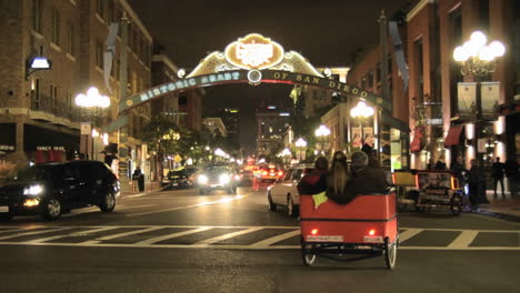 Pedicab-peddling-tourists-in-downtown-San-Diego-at-night-in-the-National-Historic-District-in-the-Gaslamp-Quarters-in-San-Diego-California