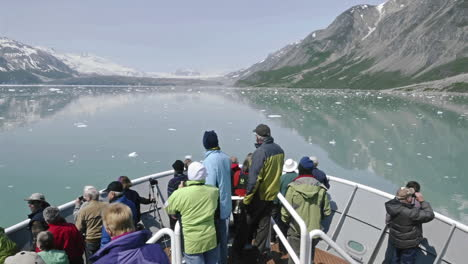 Point-of-view-Time-lapse-of-tourists-sightseeing-from-the-bow-of-a-ship-approaching-Marguerite-Glacier-in-Glacier-Bay-National-Park-Alaska