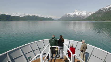Point-of-view-Time-lapse-of-tourists-on-the-bow-of-a-ship-approaching-Russell-Island-in-Glacier-Bay-National-Park-Alaska