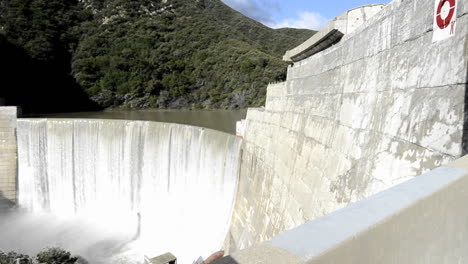 Dolly-shot-of-Matilija-Creek-spilling-over-the-obsolete-Matilija-Dam-after-a-spring-storm-near-Ojai-California-1