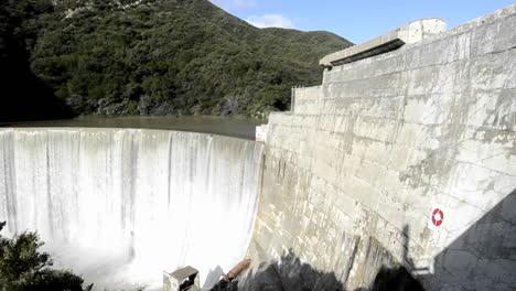 Panning-left-shot-of-Matilija-Creek-spilling-over-the-obsolete-Matilija-Dam-after-a-spring-storm-near-Ojai-California