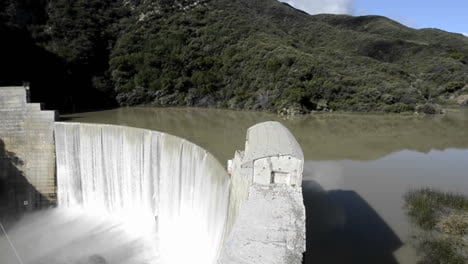 Side-view-from-above-Matilija-Creek-spilling-over-the-obsolete-Matilija-Dam-after-a-spring-storm-near-Ojai-California