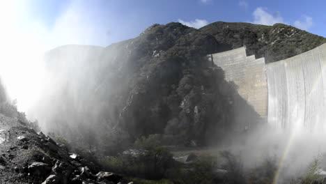 Wide-angle-panning-shot-of-rainbow-below-Matilija-Creek-spilling-over-the-obsolete-Matilija-Dam