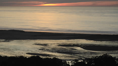 Time-lapse-of-the-sunset-reflecting-off-the-Pacific-Ocean-and-Morro-Bay-from-Black-Hills-in-Morro-Bay-California