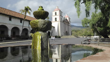 Time-lapse-dolly-shot-of-the-Mission-Santa-Barbara-reflecting-in-the-front-fountain-in-Santa-Barbara-California