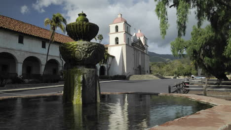 Time-lapse-dolly-shot-of-the-Mission-Santa-Barbara-reflecting-in-the-front-fountain-in-Santa-Barbara-California-1