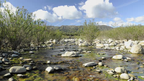 Low-dolly-shot-of-spring-clouds-passing-over-the-Los-Padres-National-Forest-and-the-Ventura-River-in-Ojai-California