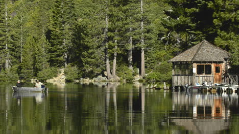 A-fishing-boat-leaving-the-Lower-Sardine-Lake-boathouse-near-the-Sierra-Buttes-in-Tahoe-National-Forest-California