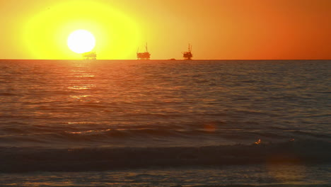 Winter-sunset-over-the-Pacific-Ocean-behind-three-oil-platforms-off-of-the-Carpinteria-coast-near-Santa-Barbara-California
