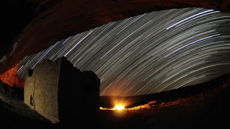 Time-lapse-star-trail-streaks-over-a-Chacoan-rock-house-in-Gallo-Wash-in-Chaco-Culture-National-Historical-Park-New-Mexico