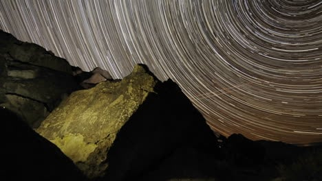Time-lapse-star-trail-streaks-over-a-sacred-Owens-Valley-Paiute-petroglyph-site-in-the-Eastern-Sierras-California
