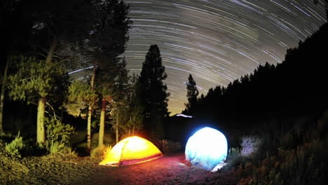Time-lapse-star-trail-streaks-over-two-lite-tents-in-Big-Meadow-in-Sequoia-National-Forest-near-Kernville-California