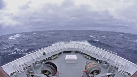 POV-of-ship-s-bow-in-a-big-wave-and-high-winds-on-the-Drakes-Passage-heading-south-the-Antarctic-