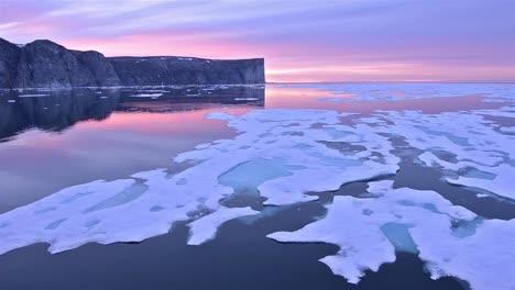 Drifting-past-sea-ice-under-the-midnight-sun-on-Scott-Island-off-Baffin-Island-in-Nunavut-Canada
