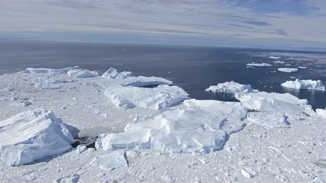 Aerial-of-ice-packed-into-the-Ilulissat-Icefjord-below-Jakobshavn-Glacier-or-Sermeq-Kujalleq-near-Ilulissat-Greenland