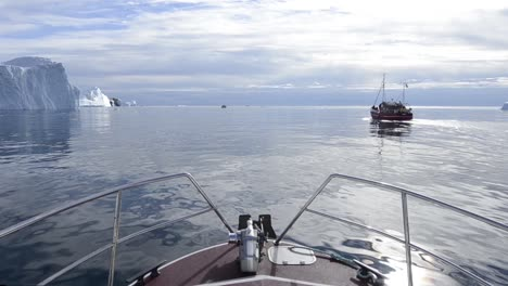 POV-of-a-red-tourist-boat-cruising-along-the-terminal-moraine-of-the-Ilulissat-Icefjord-below-Jakobshavn-Glacier