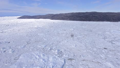 Aerial-of-ice-packed-into-the-terminal-moraine-of-the-Ilulissat-Icefjord-below-Jakobshavn-Glacier-or-Sermeq-Kujalleq