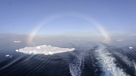 Fog-bow-over-the-sea-ice-from-the-stern-of-the-ship-at-80-degrees-north-in-Svalbard-Norway-