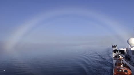 Fog-bow-over-the-sea-ice-with-the-ship-at-80-degrees-north-in-Svalbard-Norway