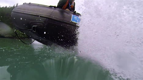 Nice-POV-perspective-shot-of-a-rubber-zodiac-inflatable-boat-traveling-on-a-lake-or-river