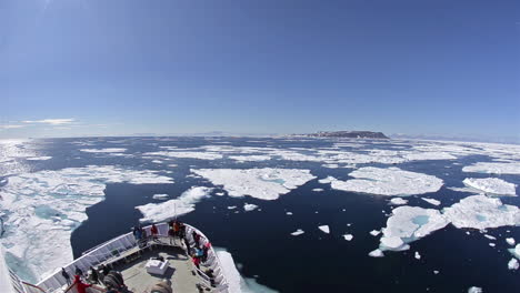 A-ship-travels-through-the-northwest-passage-in-East-Greenland-with-icebergs-surrounding