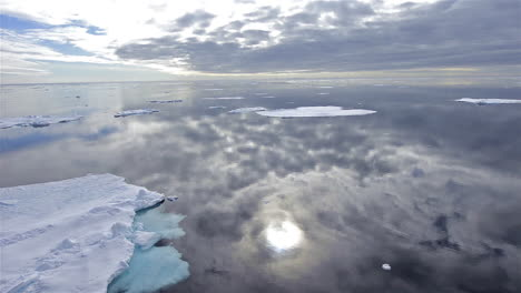 Sea-ice-is-seen-in-the-Arctic-ocean-with-a-perfect-reflection-of-the-ocean