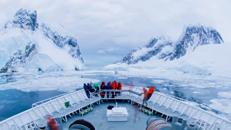 A-POV-time-lapse-shot-of-a-ship-bow-icebergs-and-tourists-passing-through-Lemaire-Channel-Antarctica