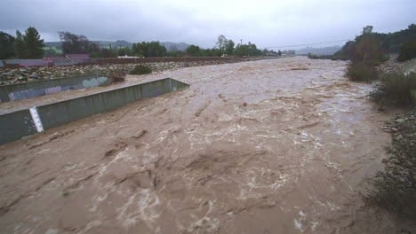 A-river-in-Southern-California-begins-to-flood-during-a-large-storm