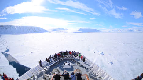 A-POV-time-lapse-shot-of-a-ship-bow-icebergs-and-tourists-passing-through-Lomfjorden-near-Svalbard-Norway-1