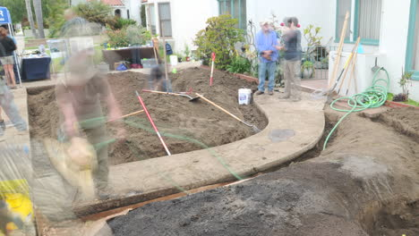A-large-community-builds-a-garden-in-the-front-yard-of-a-home