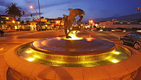 Traveling-time-lapse-shot-of-the-dolphin-fountain-near-State-Street-in-downtown-Santa-Barbara-California