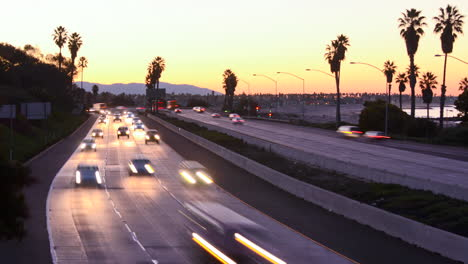 Time-lapse-cars-travel-on-a-freeway-at-sunset-or-dusk